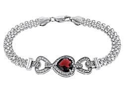 TEH448<br>3.20ct Heart Shape Vermelho Garnet(Tm) And .59ctw Round White Topaz Sterling Silver Bracel
